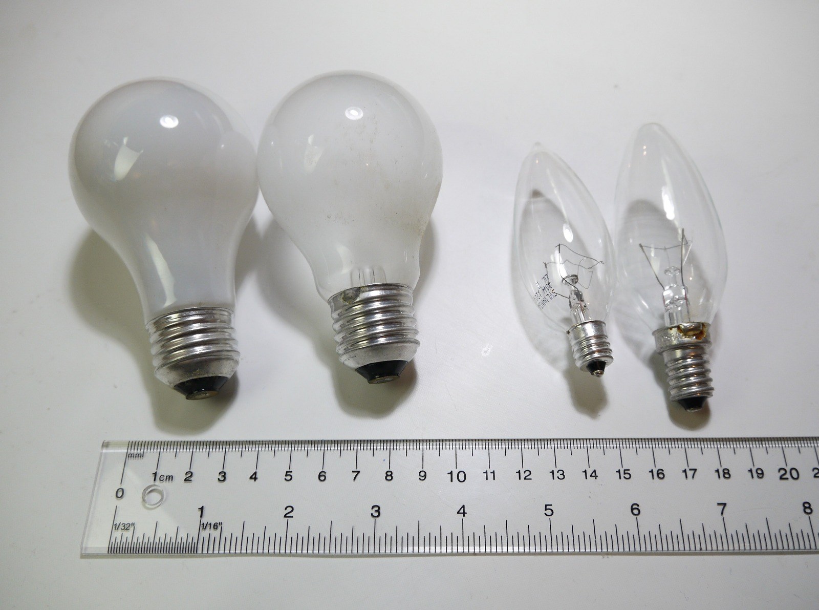 Four Of The Most Common Light Bulbs: US A19 With E26, European E27, US B10  With E12, European E14